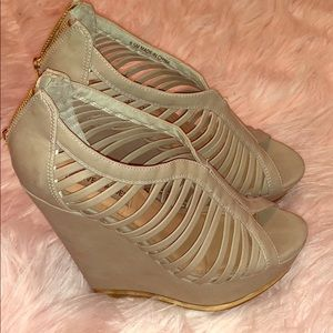 Steve Madden wedges with a gold trim and zipper.
